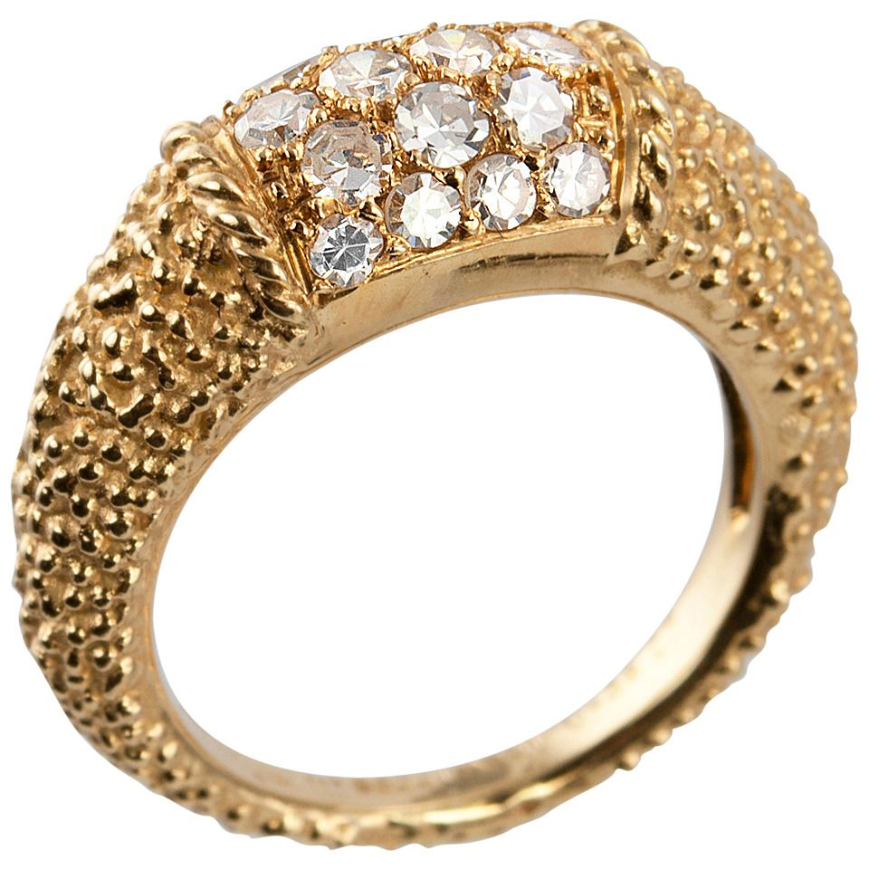 Van Cleef & Arpels Philippine ring with 18 round diamonds in 18 karat yellow textured gold. These rings look great stacked with others as well as on their own! This ring measures approximately 7 millimeters in width and 6 millimeters in depth and has approximately 0.38 carats of diamonds. Circa 1960s-1980s.