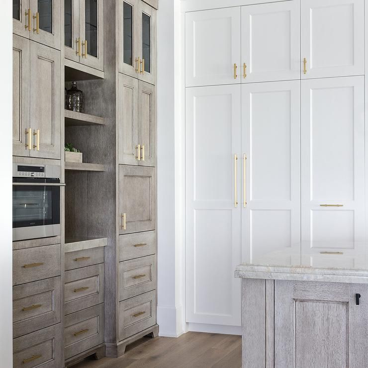 Long Kitchen Cupboards: Floor To Ceiling White Shaker Cabinets Accented With Long