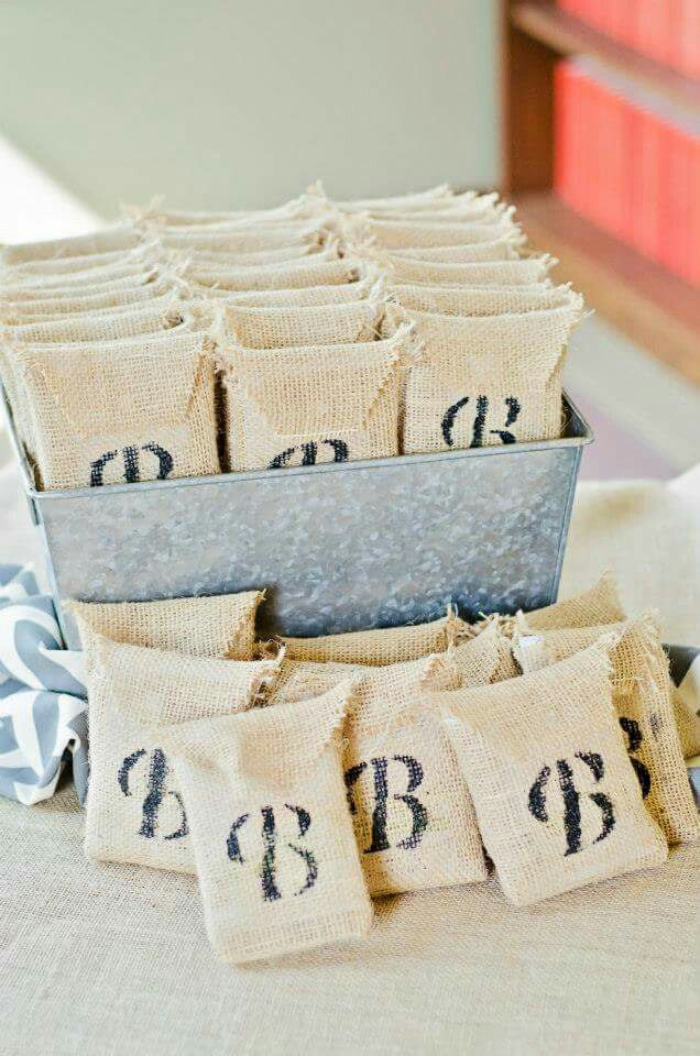 """Burlap bags with daisy seeds. Frame read """"Plant these seeds and when they bloom remember the love shared today by the Bride and Groom""""."""