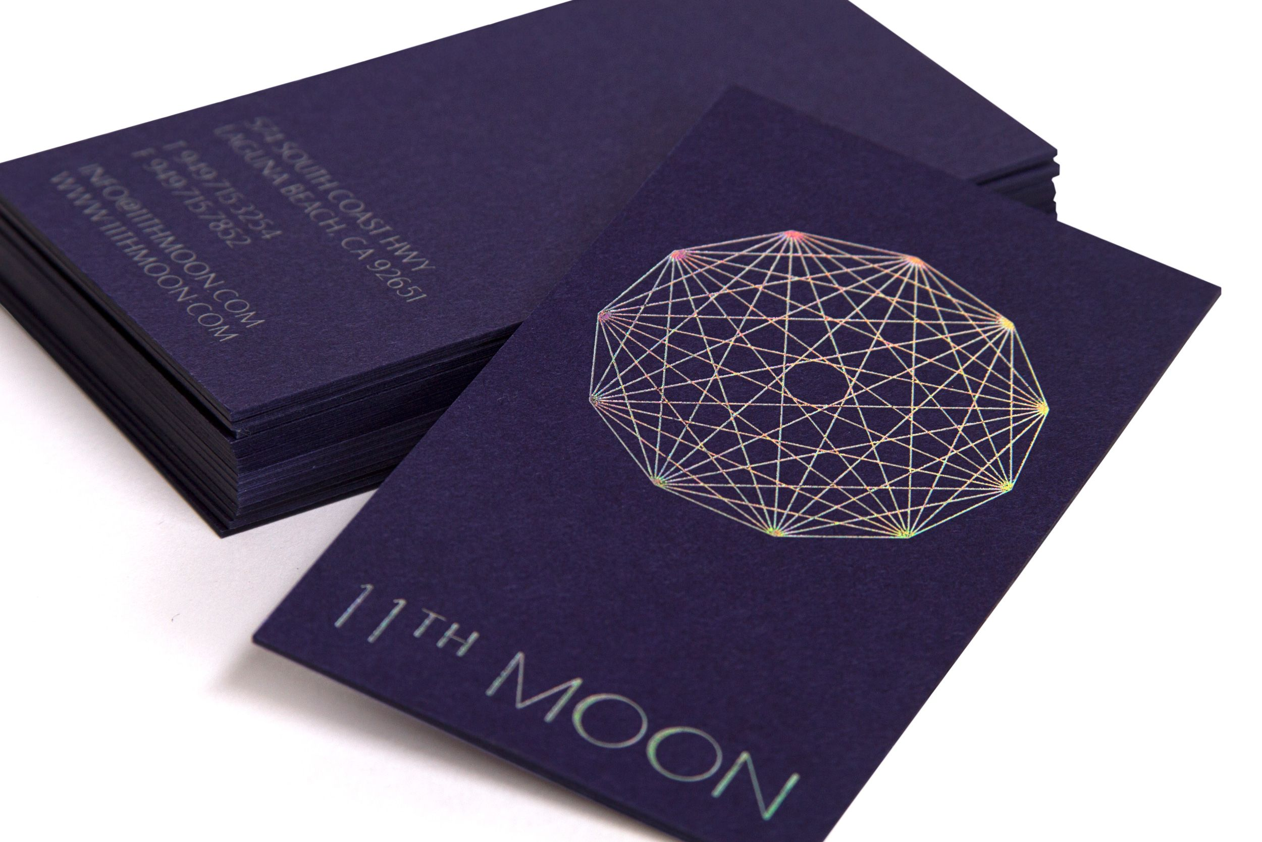 purple board business card with holographic foil detail designed