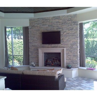 Isokern Fireplace With Cast Stone And Stone And A Tv Installed