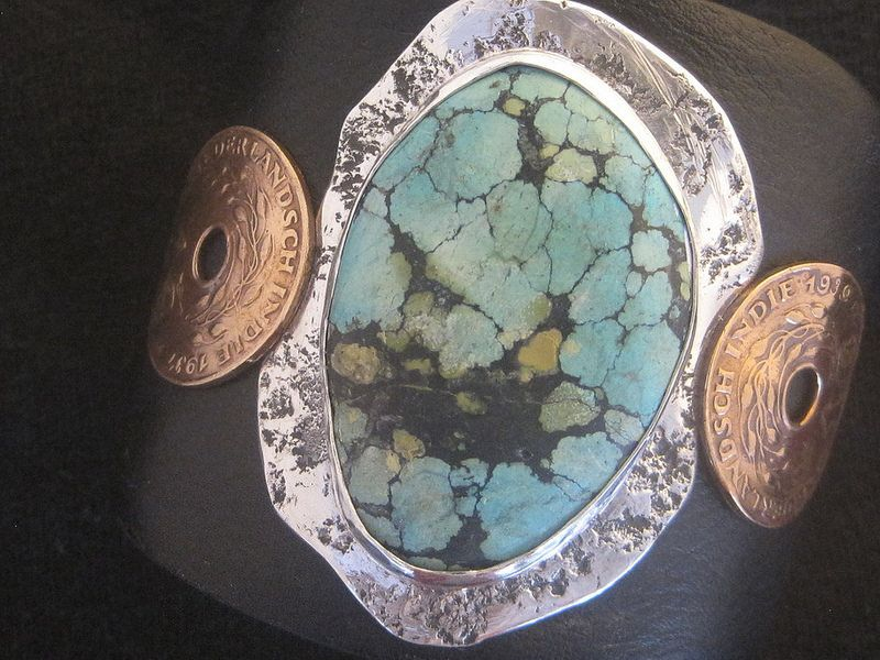 South Park   Flickr - Photo Sharing! Turquoise and rock textured sterling sivler with Dutch  East Indies coins from the 30's on leather cuff. www.e-bu-jewelry.com
