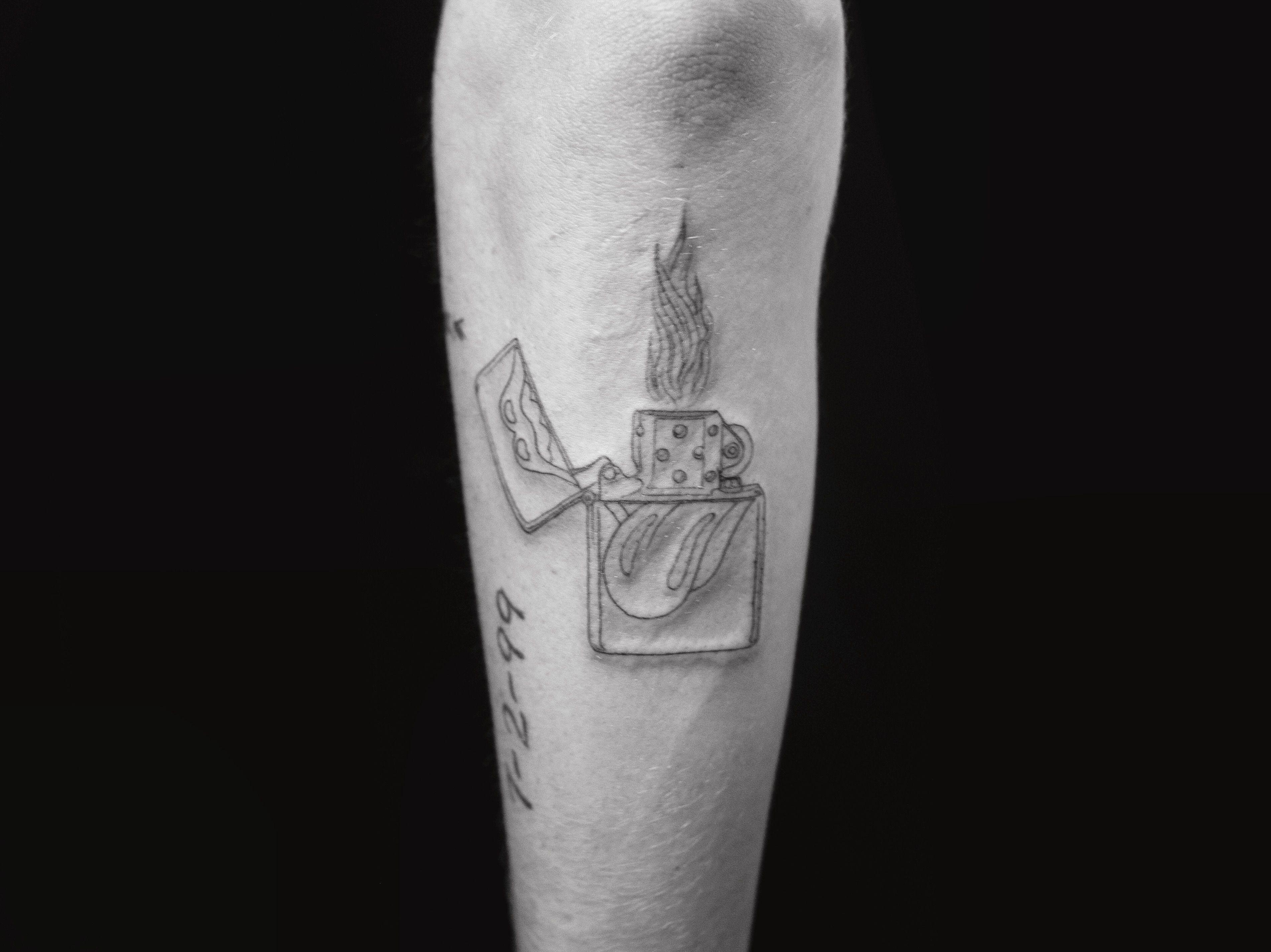 Single needle Rolling Stones zippo lighter tattoo on