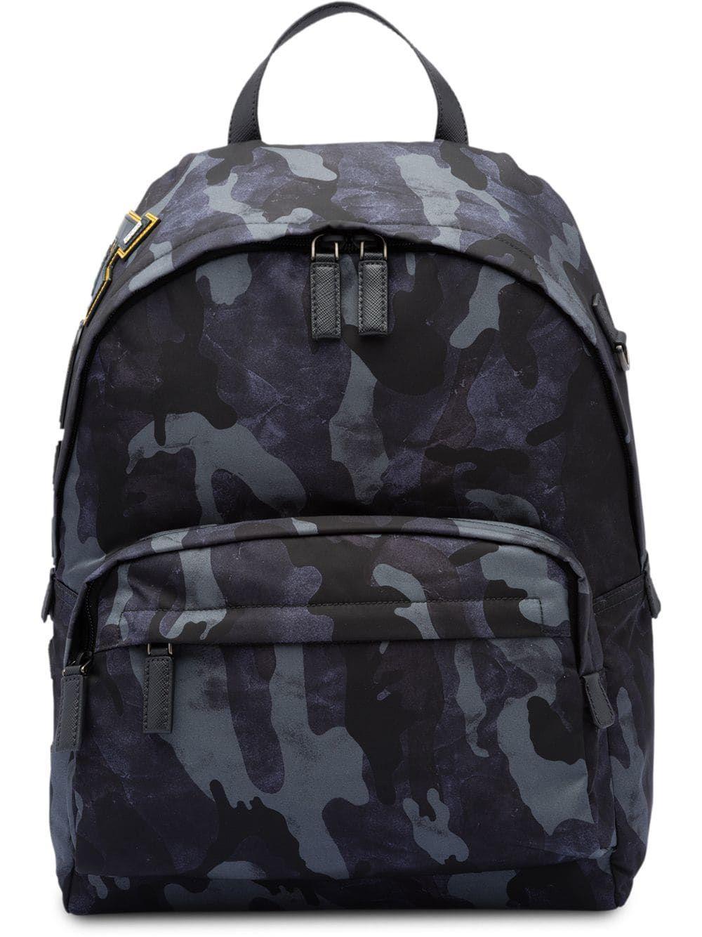 b026af278fcb2b PRADA PRADA CAMOUFLAGE PRINT BACKPACK - BLUE. #prada #bags #backpacks