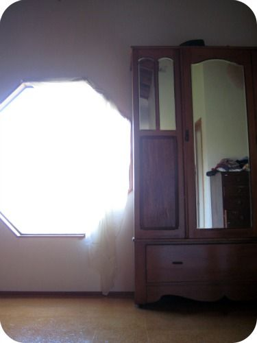 neat window, wood floors, great wardrobe