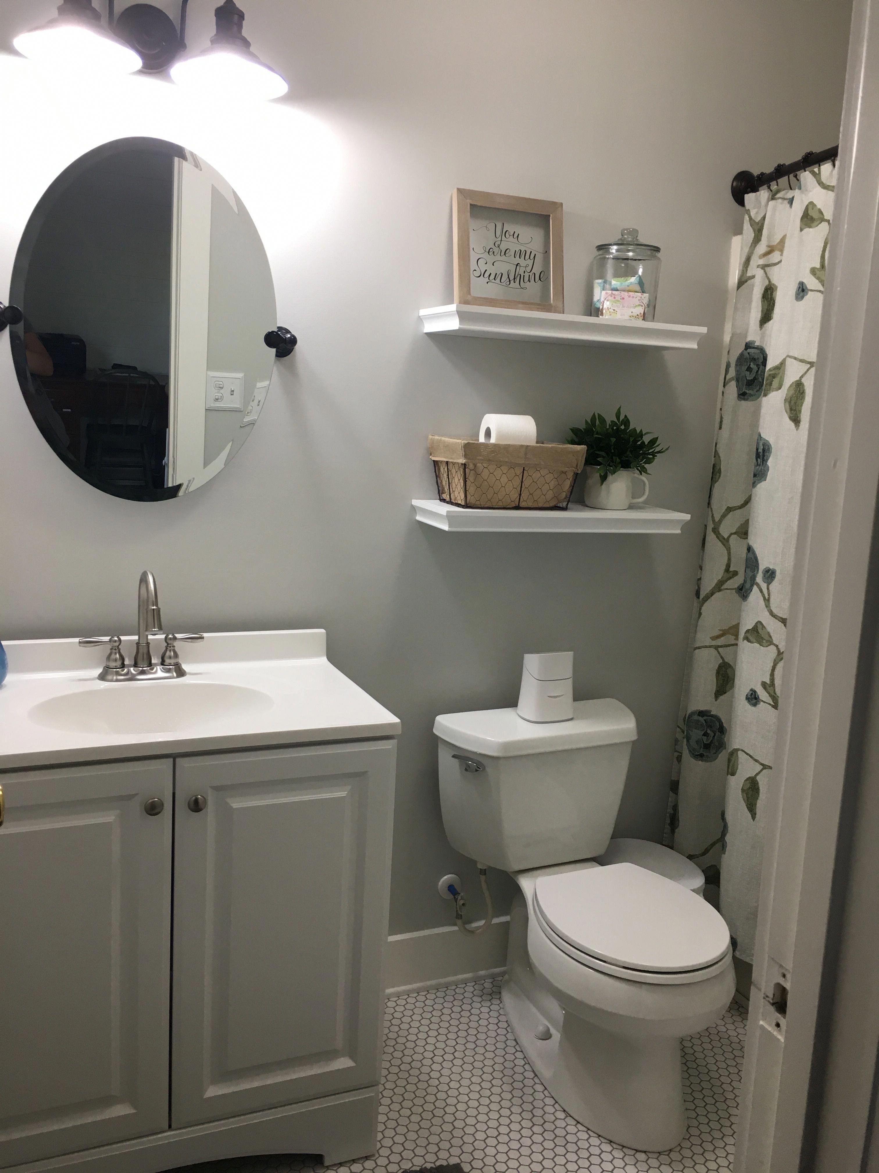 Cottage style bathroom; BM Moonshine; white shelves ...