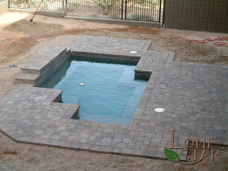 belgard sierra blend dublin pavers and coping around swimming pool