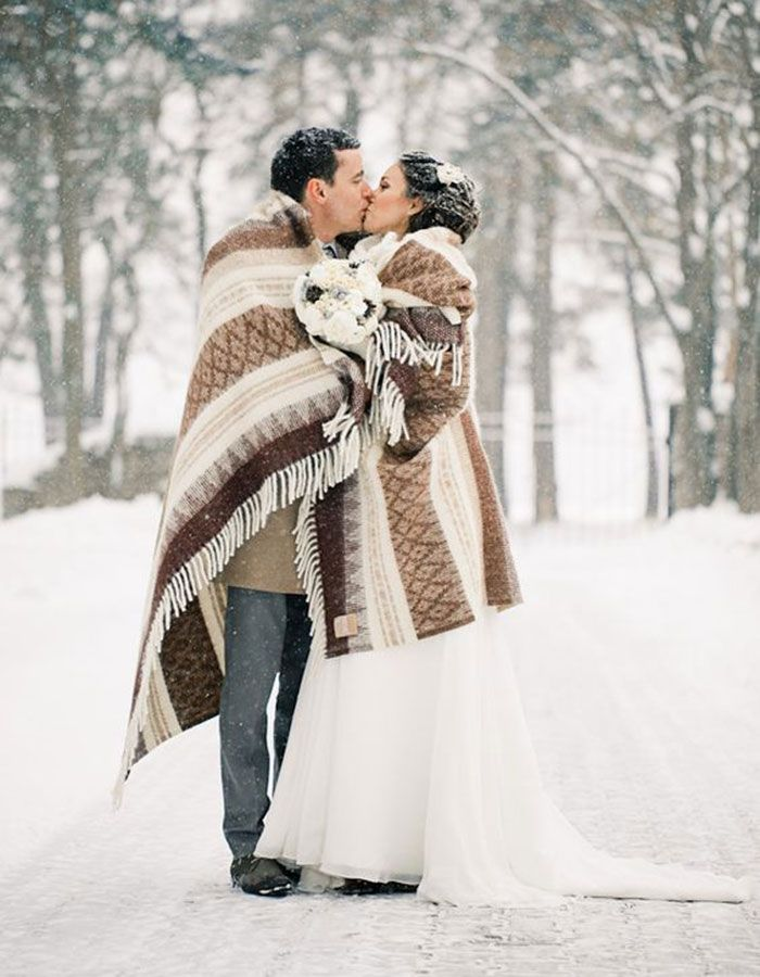 Photo of 12 Welcoming Ways To Make Your Cold Weather Wedding Feel Warm and Cozy