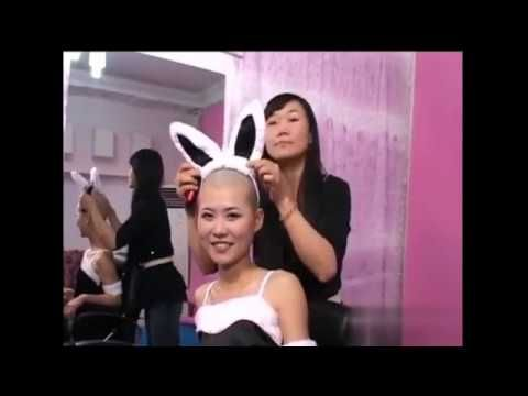 Share video of woman getting head shaved