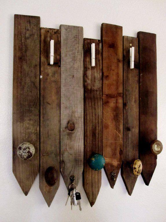 coat rack using old door knobs and fencing@Hannah Baker