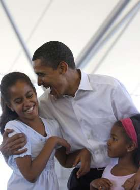 Joking around with his daughters, Malia and Sasha, during a family picnic in Fort Wayne, Indiana in ... - Getty