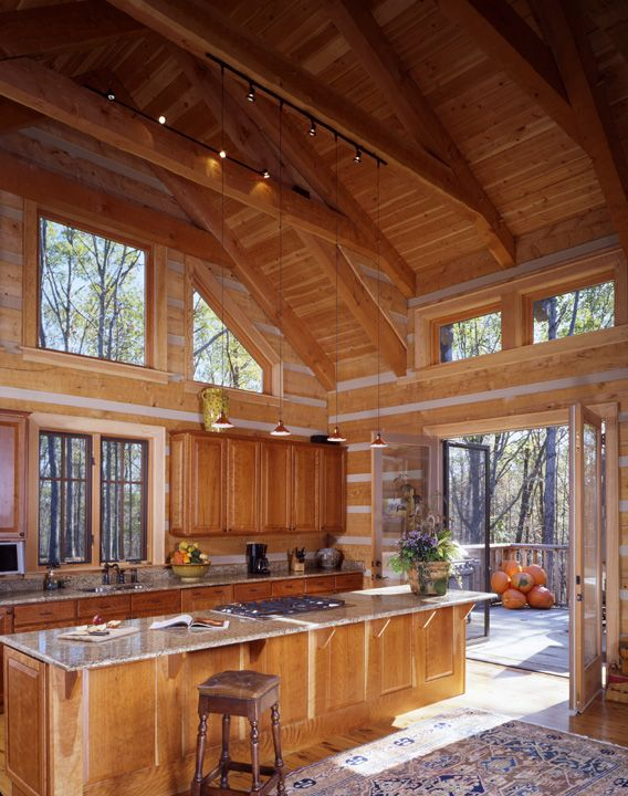 Kitchen With Huge Island And Vaulted Heavy Timber Ceiling Rustic