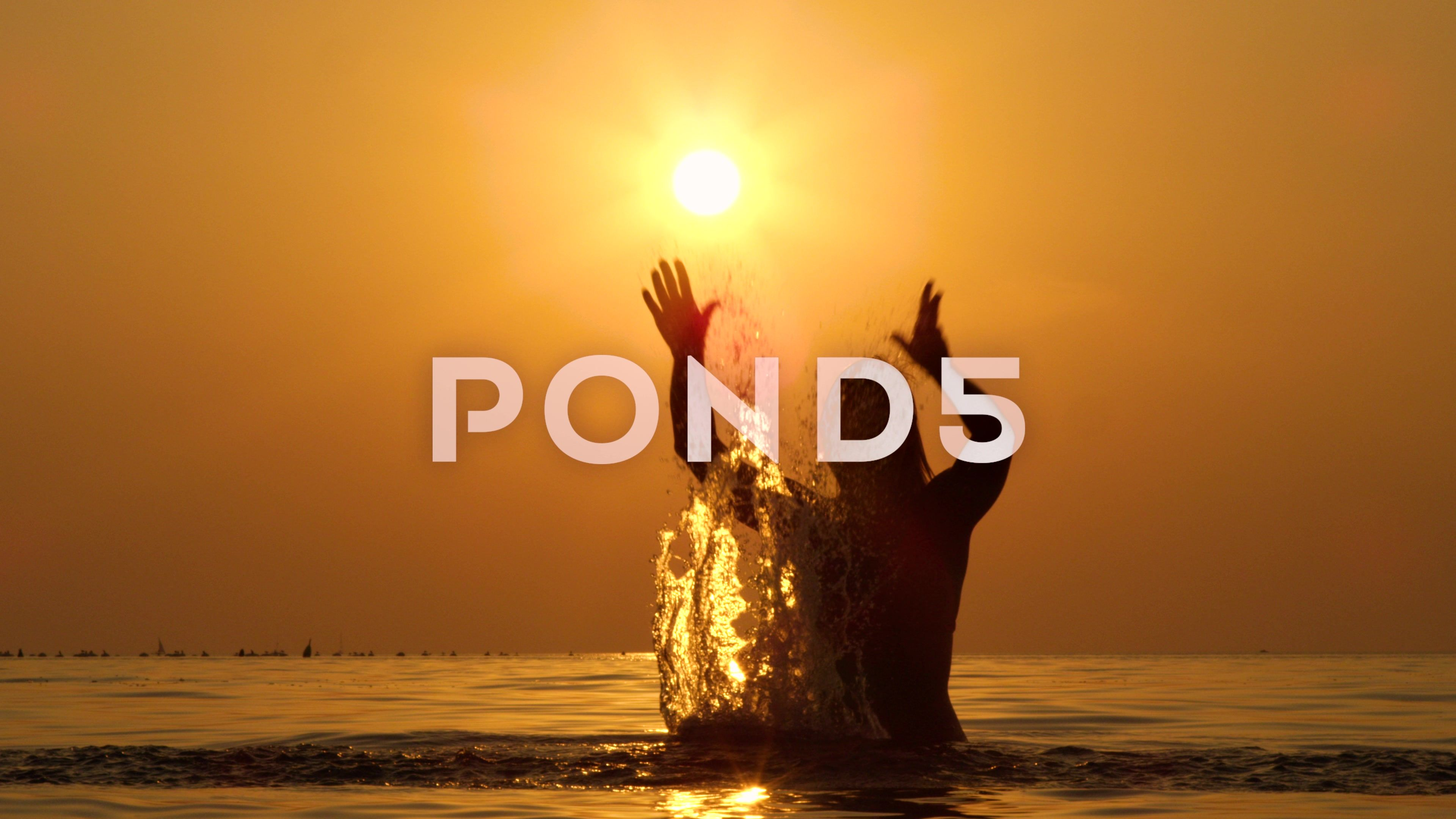 SLOW MOTION Cute woman standing in shallow ocean and