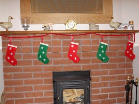 A 2 metre long stocking garland of alternate green and red felt stockings with snowflakes on.