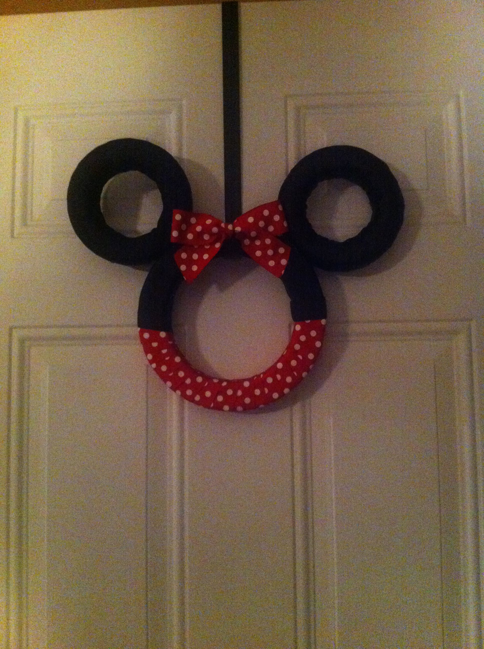 My Minnie Mouse wreath I made for my front door!!  I'm not quite done with it but it's too late to go back to the craft store.  I'll post again when I'm finished.