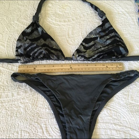 Vitamin A reversible bikini Top reverses from solid gray to an animal print. Shiny material. In excellent condition. Gently worn, handwashed and air dried. Top is Large. Bottoms are medium. Has cute braided detailing Vitamin A Swim Bikinis