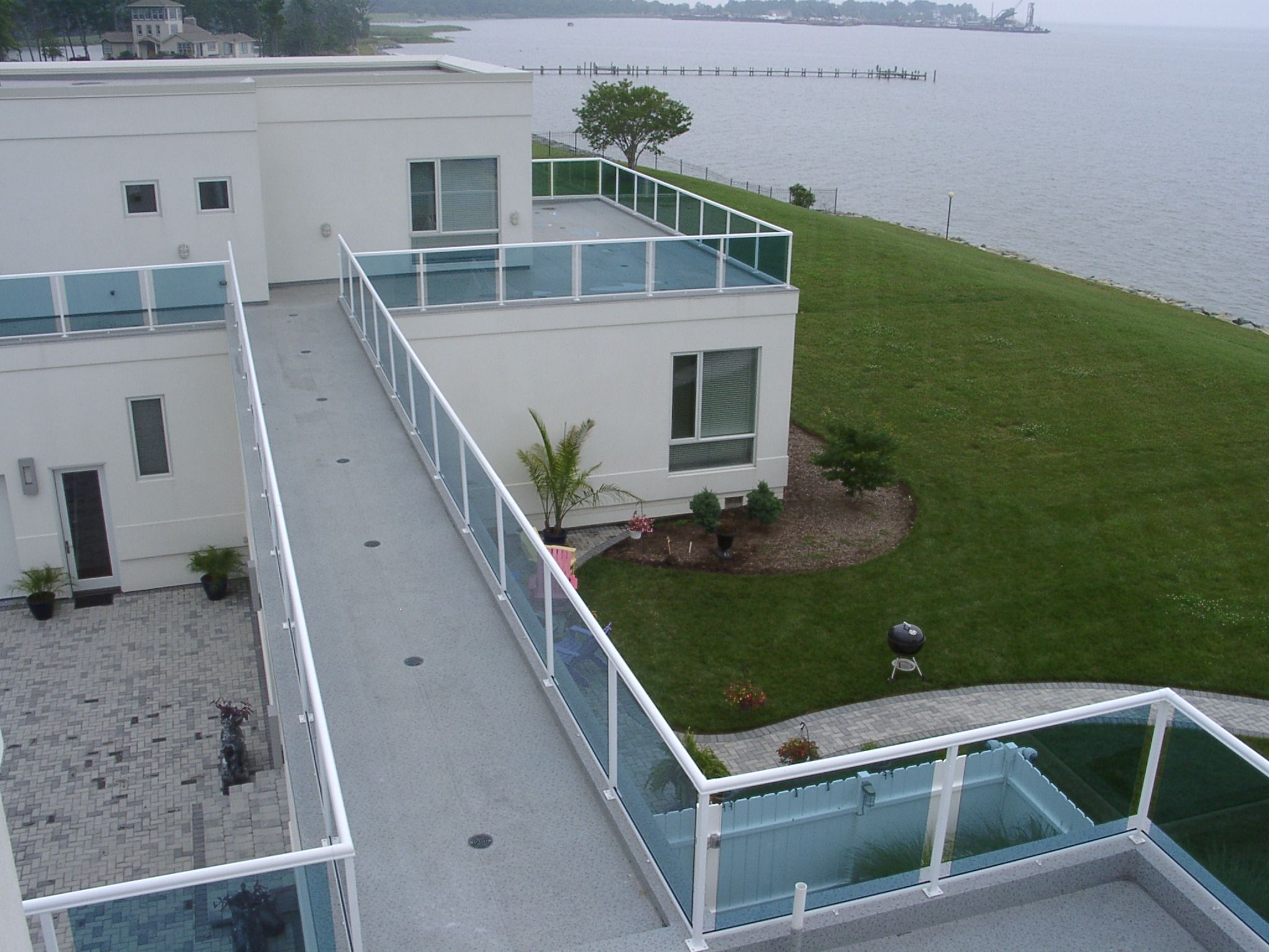 Glass railings for decks - Duradek Rooftop Deck And Walkway With Durarail Glass Railing In Stevensvile Md