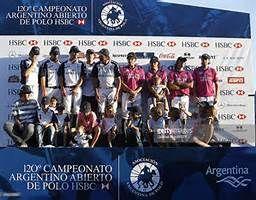 Team of La Dolfina and team of La Alegria pose for a photo after the ...