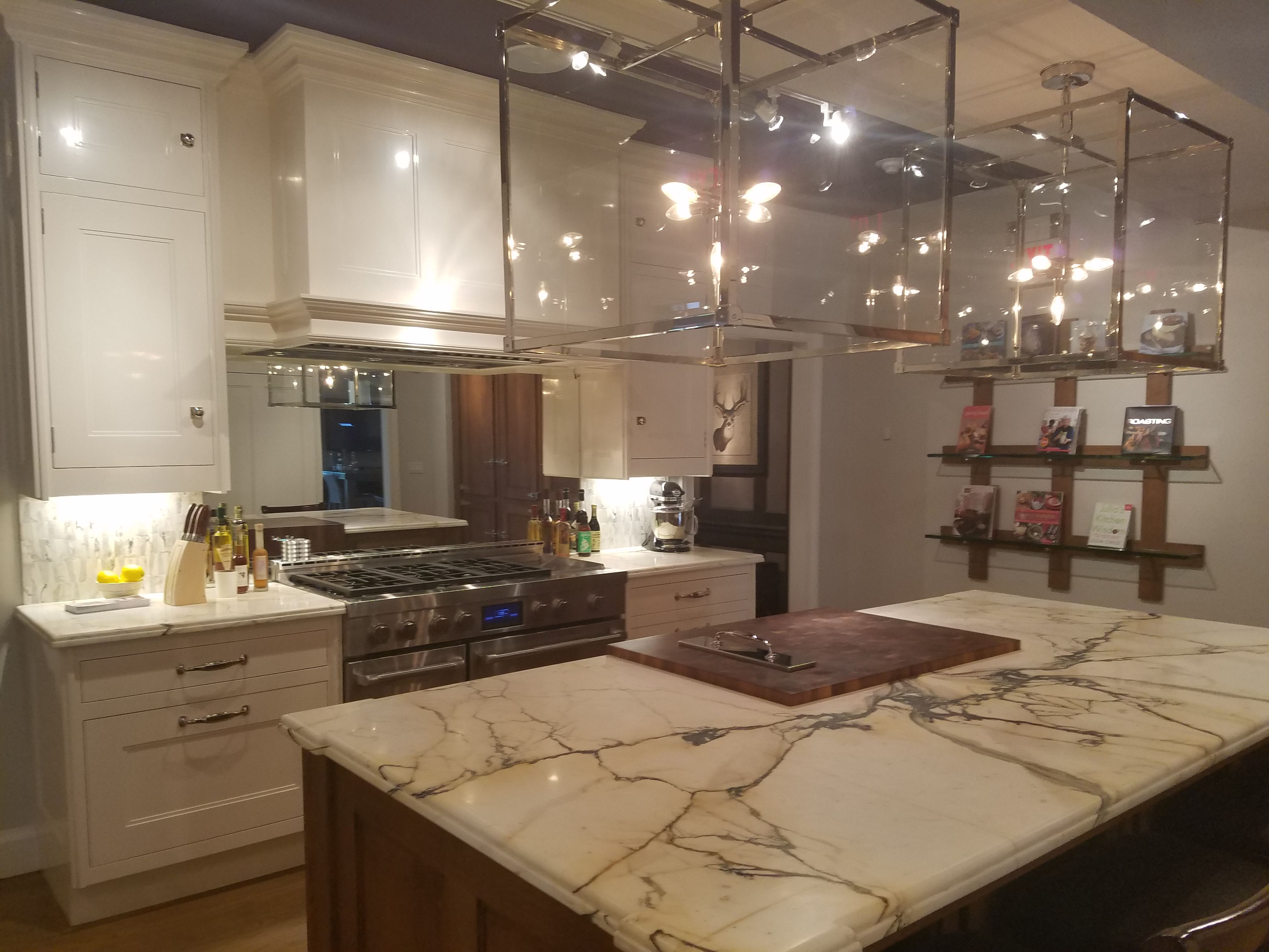 Cabinets refectory and lighting and built in stove fan kitchen