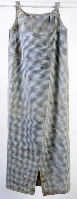 ca. 1800 Smocks used to protect one's clothing while undertaking messy household chores rarely survive from early America. This rare example of a woman's everyday work clothes is made of the blue and white checked cloth that was also commonly used for women's aprons and men's shirts. The several stains and patches suggest the hard use such garments saw;
