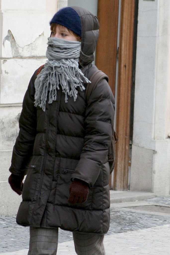 https://flic.kr/p/8cqFyt | Young girl in cold winter Prague hood up in puffy downcoat, face covered by scarf | Young girl in cold winter Prague hood up in puffy downcoat, face covered by scarf