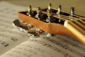 Image result for photo of guitar and sheet music