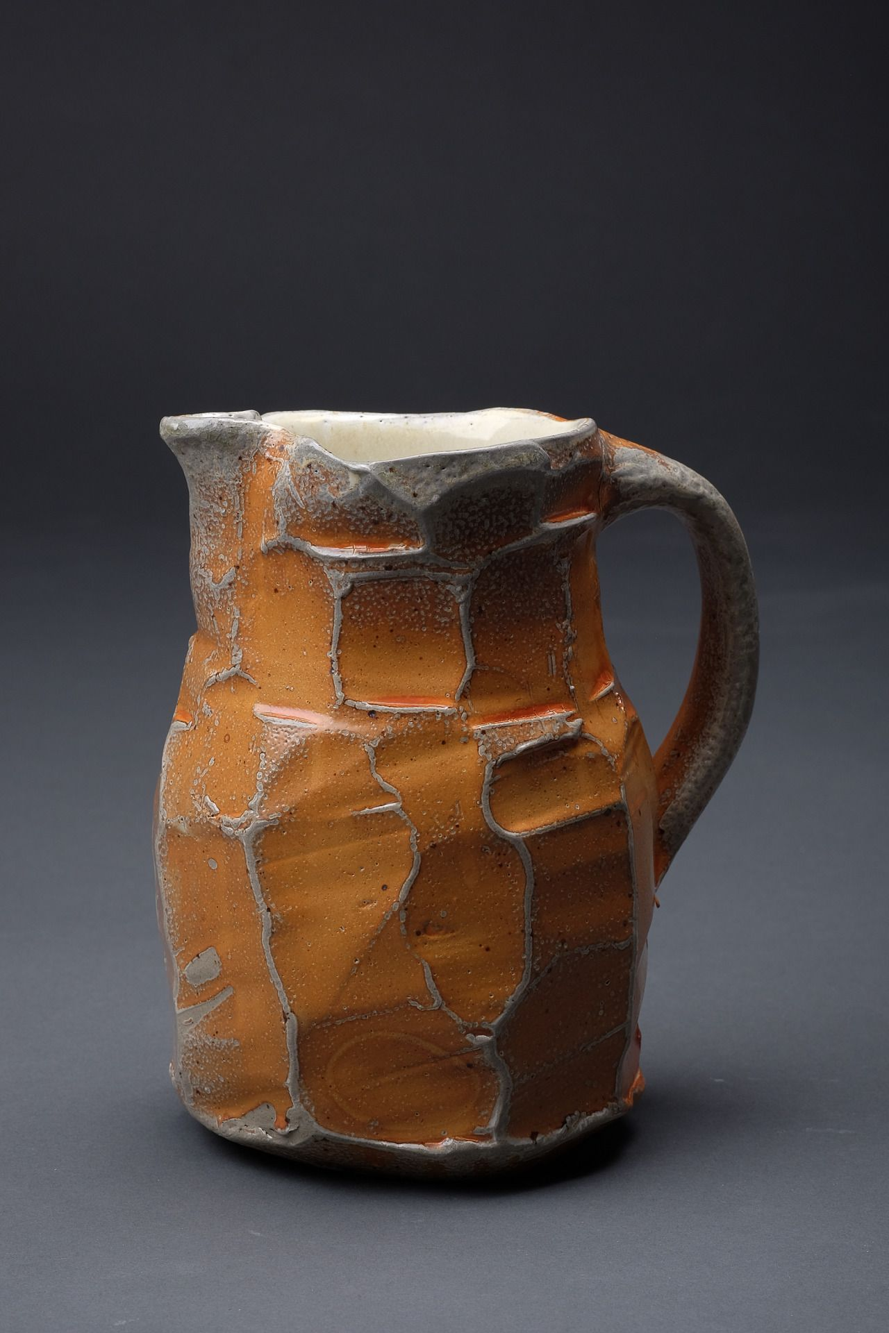 Soda fired faceted pitcher