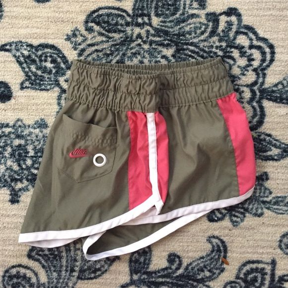 Nike Athletic Running Shorts Nike Shorts in a grey green and pink trimmed with white. Excellent condition. Excellent price. Don't wait. Nike Shorts
