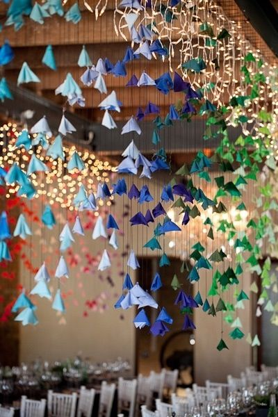 Strings Of Paper Flowers Hanging From The Ceiling Origami