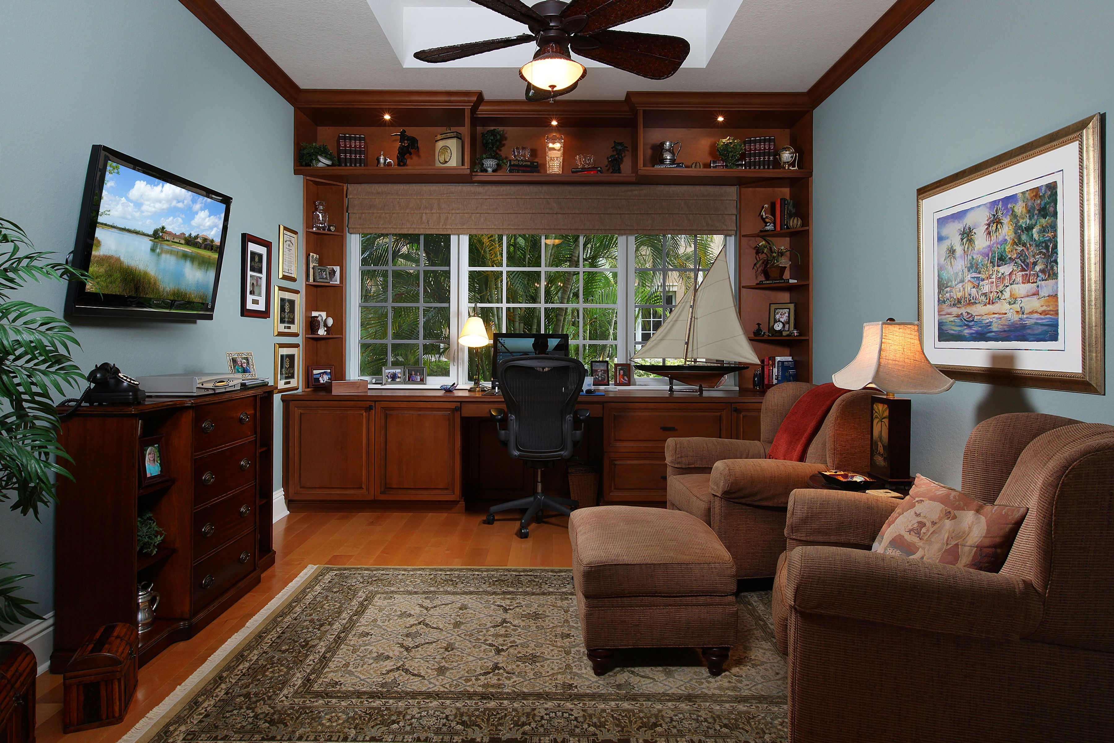 Stunning study with wood floors and built-in desk.