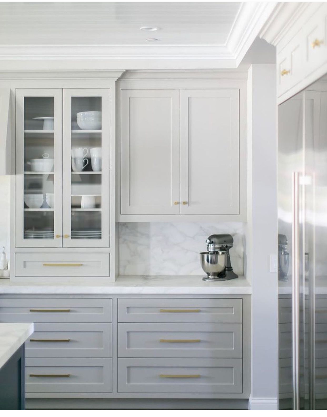 white kitchen cabinets with glass doors high gloss like the layout of full cabinet to counter next half which creates space for applicances toaster oven style and placement