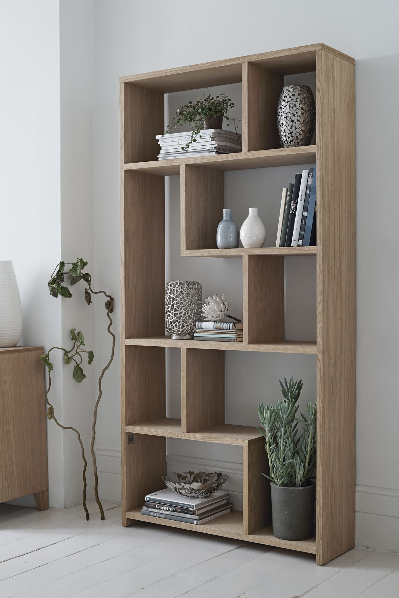 Don T Just Limit Yourself To Books On Your Shelving Unit Add Vases And Plants For The Perfe Shelving Units Living Room Living Room Shelves Shelving Unit Decor