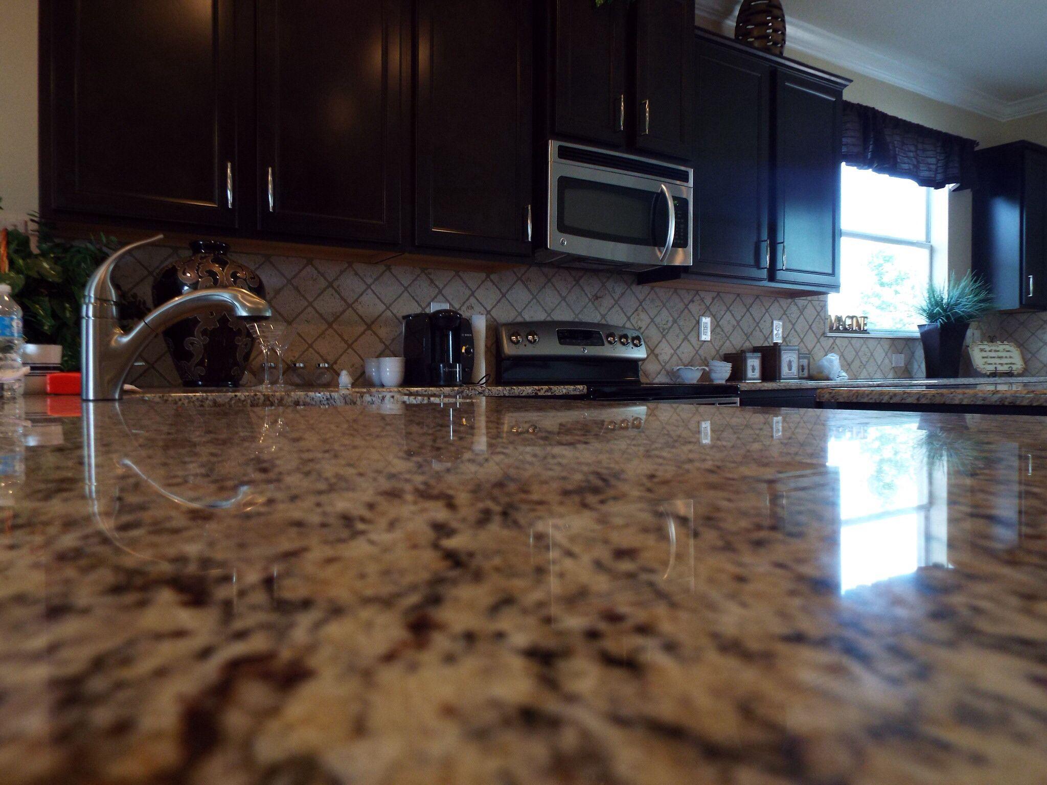 Granite countertops sarsaparilla color Aristakrat cabinets in