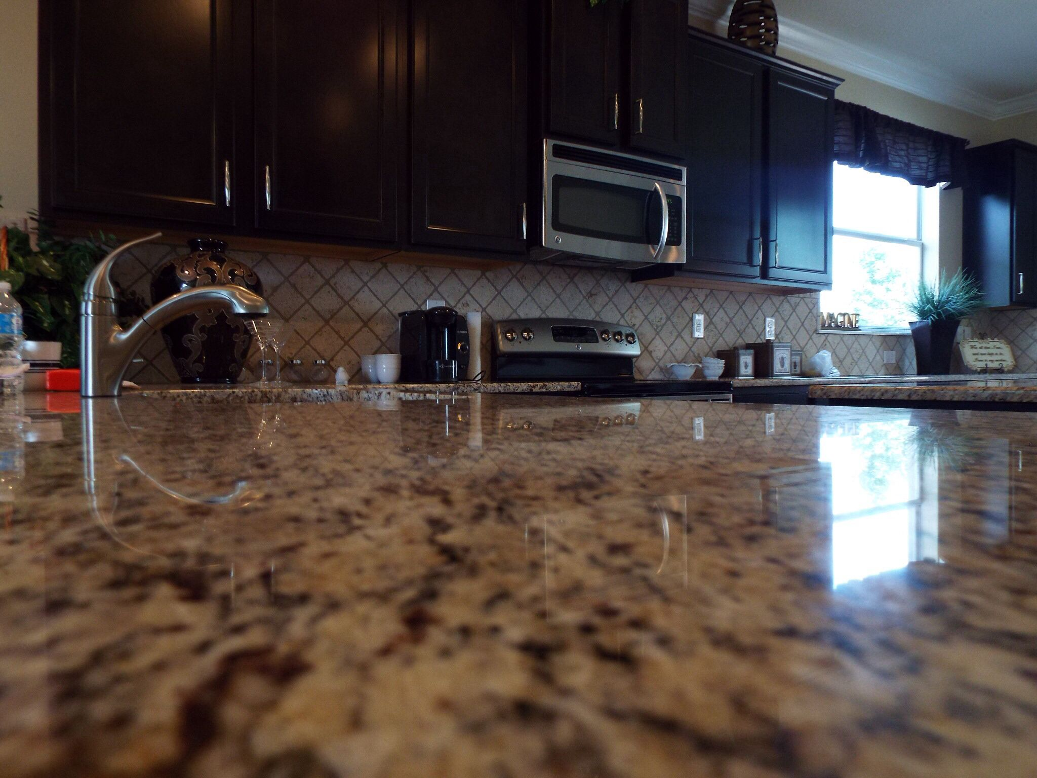 High Quality Granite Countertops, Sarsaparilla Color Aristakrat Cabinets In D.R.  Hortonu0027s Homes In Tampa, Florida.