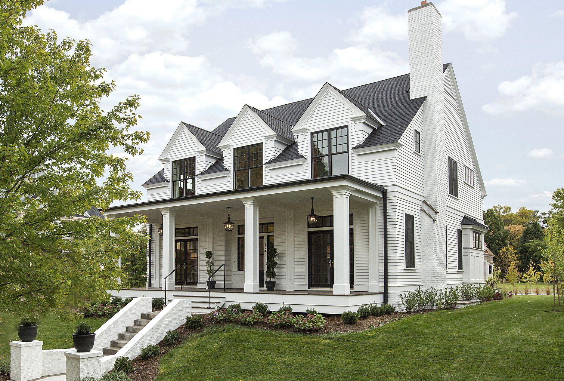 Modern Colonial Home Exterior Black Windows White House Columns White Exterior Houses Modern Farmhouse Exterior Exterior House Colors