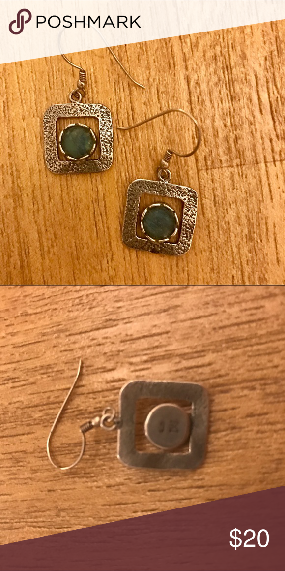 Silver earrings From Israel. These were a gift so I cannot confirm the material or stone, but they appear to be sterling silver. Jewelry Earrings