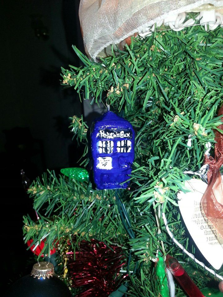 My mom is a huge Dr. Who fan, so I made her this TARDIS for her tree... :-) made from Sculpey clay and acrylic paint.