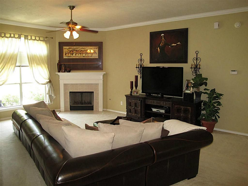 family room with corner fireplace | family room featuring corner ...