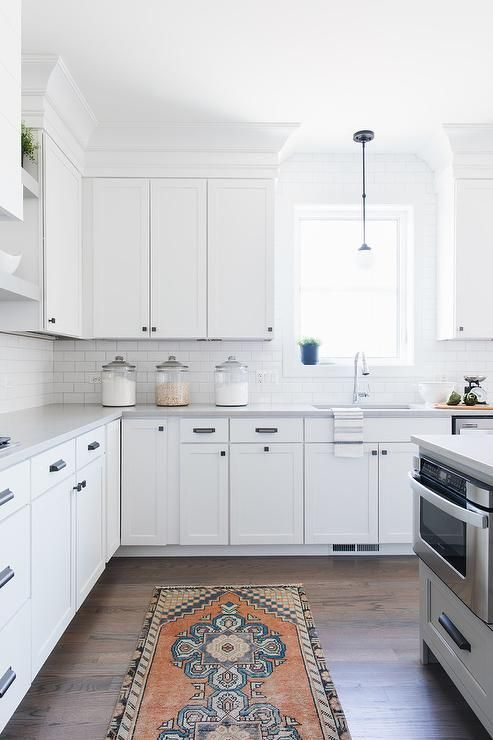 White Shaker Kitchen Cabinets Donning Oil Rubbed Bronze Hardware And White  Quartz Countertop Wrap Around To