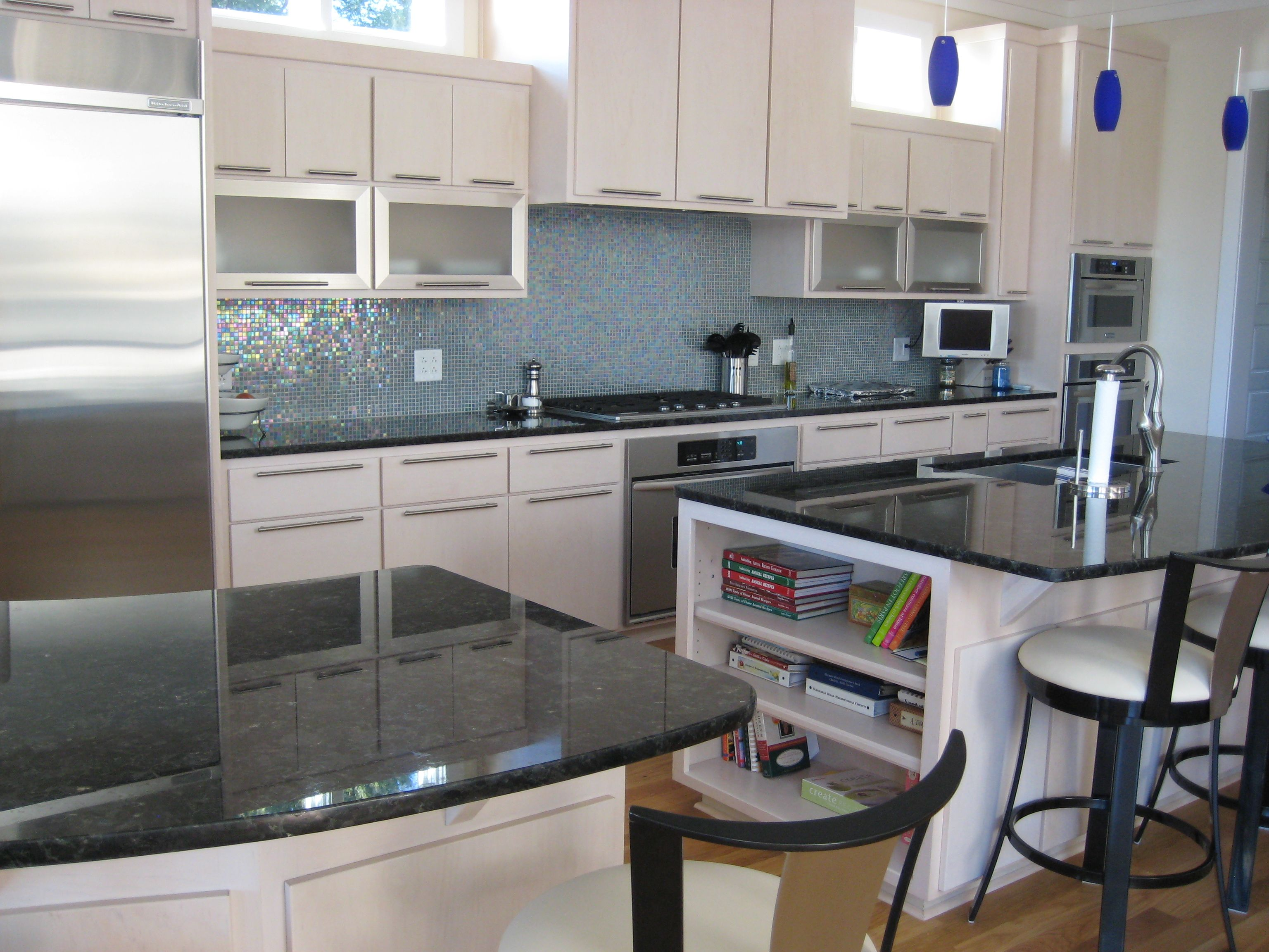 Contemporary Kitchen Featuring Gourmet Appliances, Volga Blue Granite,  Irridescent Glass Tile Backsplash, Lots