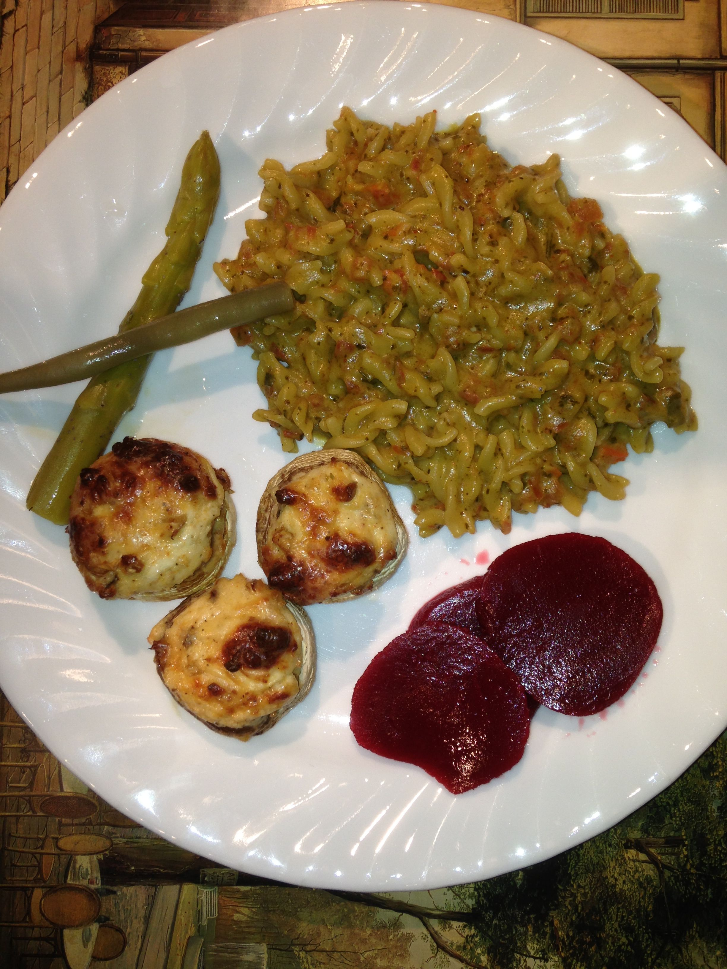 Pesto and salsa fusilli with reggiano stuffed mushrooms.   http://m.allrecipes.com/recipe/15184/mouth-watering-stuffed-mushrooms