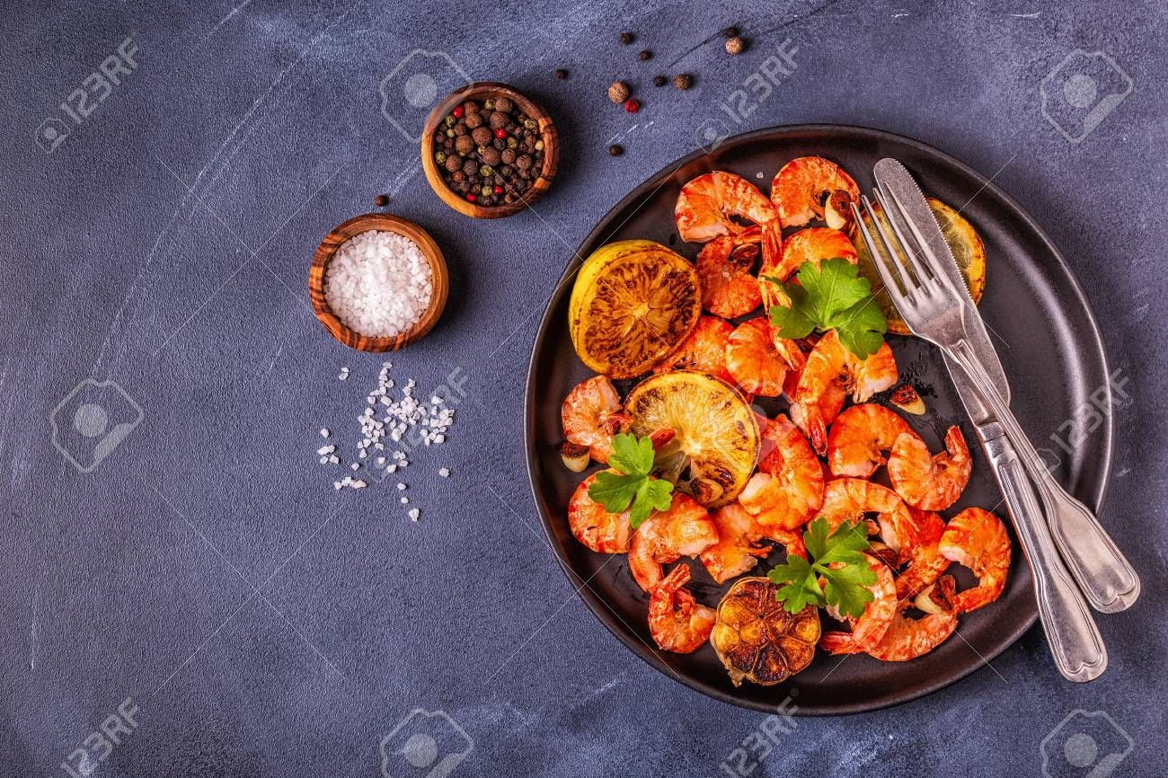 Grilled shrimps with lemon parsley and garlic, top view. ,