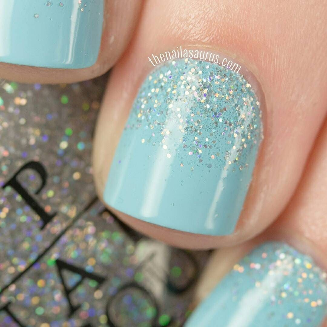 One last shot of the glitter gradient using OPI I Believe in Manicures (tiffany blue) and Champagne for Breakfast (holo glitter) #OPIxBreakfastAtTiffanys #OPI