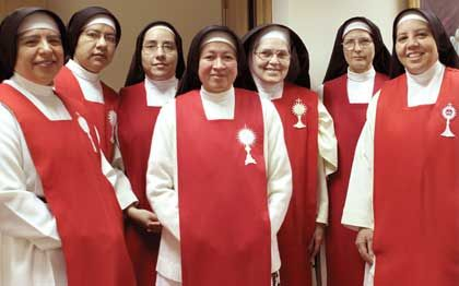 Six nuns from the Sisters of Perpetual Adoration joined the three sisters at Blessed Sacrament Monastery in Anchorage. From left are newly arrived nuns: Sister Sylvia, Sister Marisela, Sister Cristal and Sister Imelda along with Mother Maria de la Milagrosa (the community's superior who was previously stationed), Sister Evelia Alicia and Sister Maria Guadalupe. — Photo by Patricia Coll Freeman