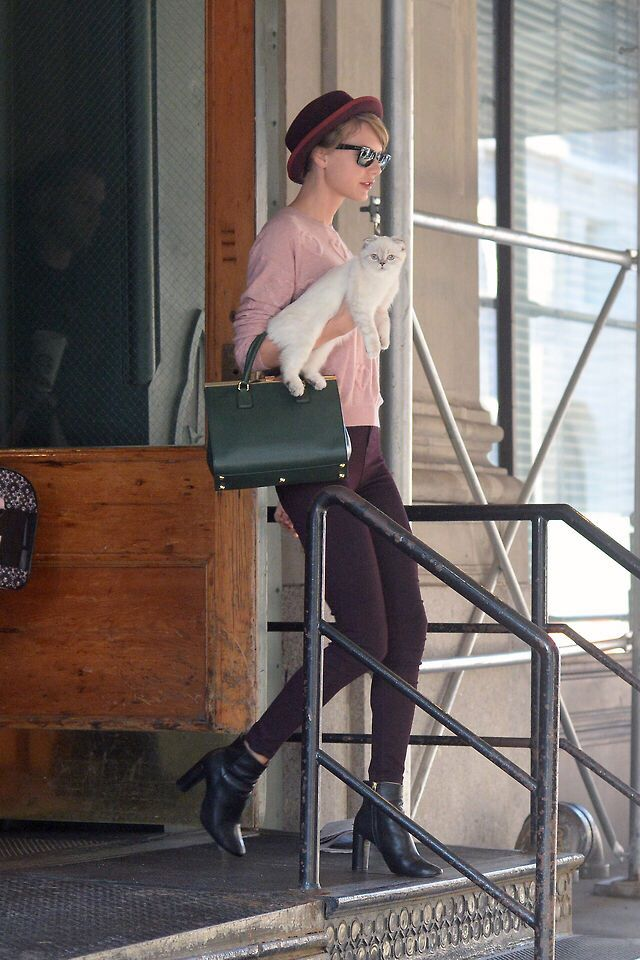 Leaving her apartment with her cat Olivia in NYC 9/23/14