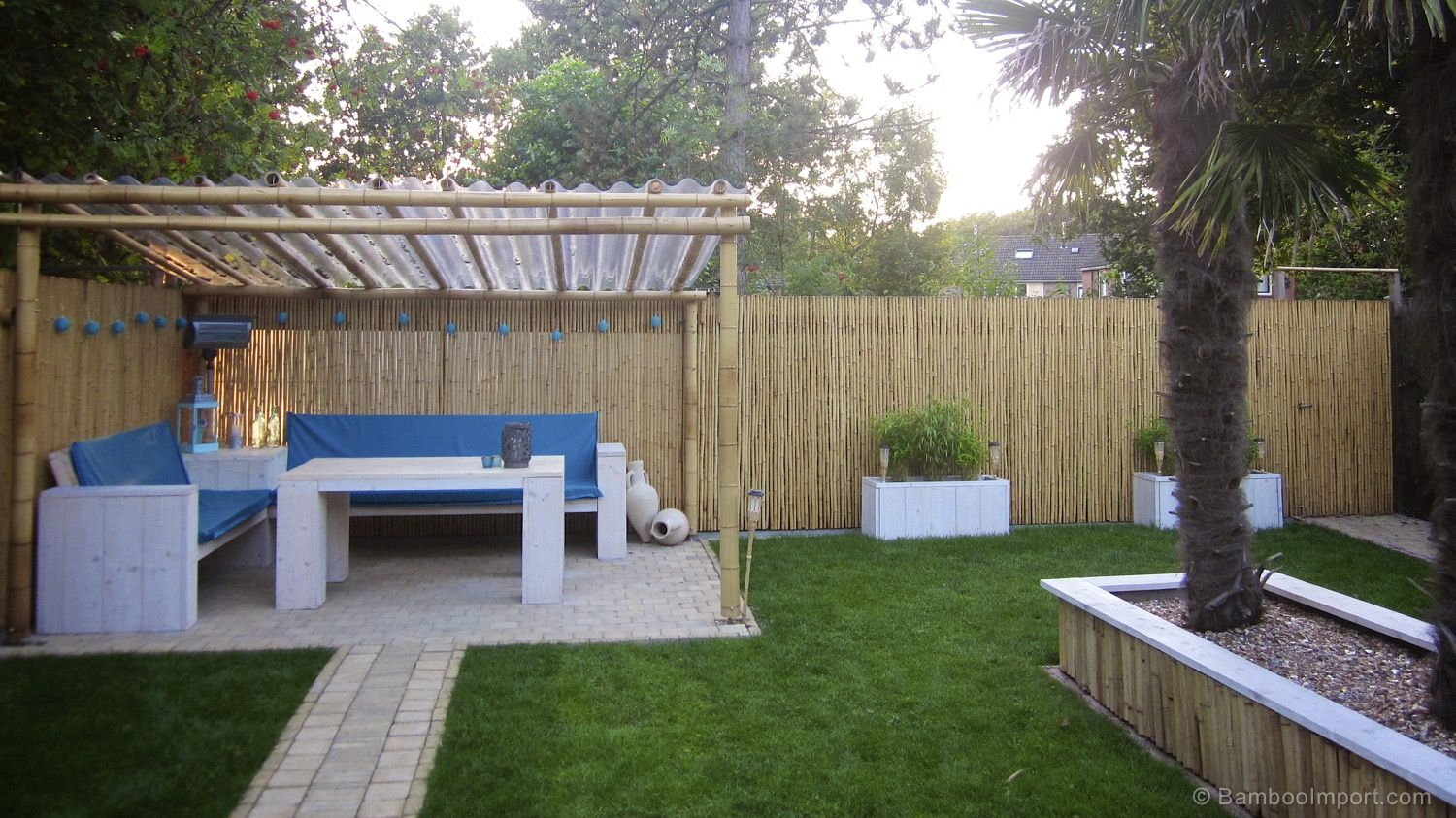 Best Bamboo Fencing For Garden And Outdoor Design: Pergola And Bamboo  Fencing With Patio Furniture And Patio Pavers Also Walkways With Lawn And  Box Planters ...