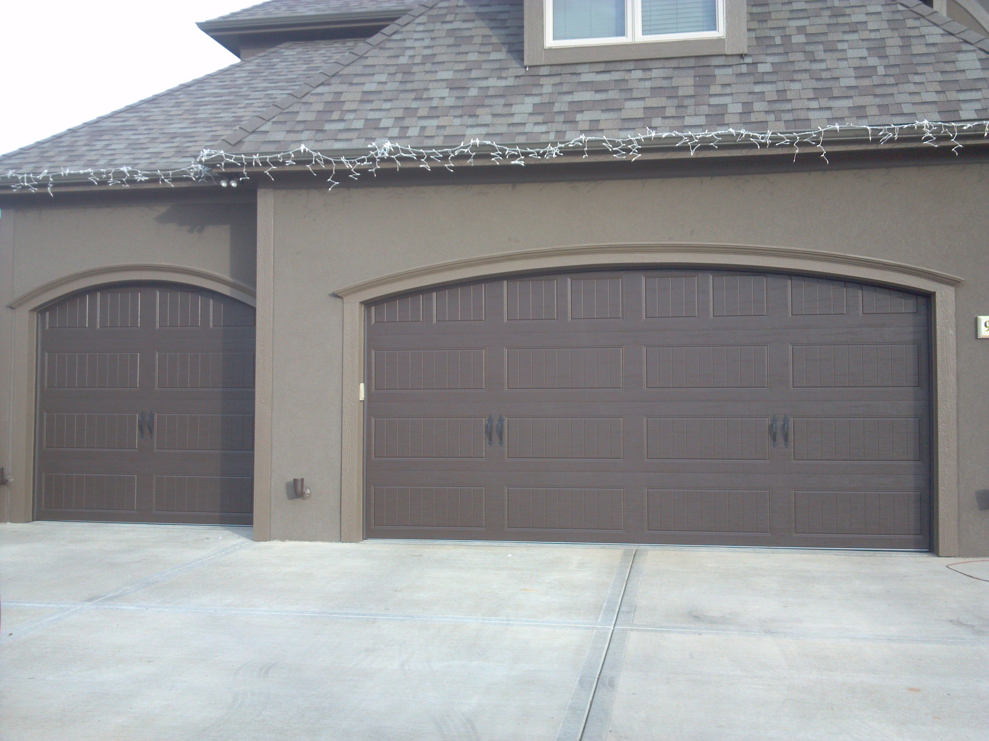 Clopay gallery collection arched opening steel insulated for Clopay steel garage doors