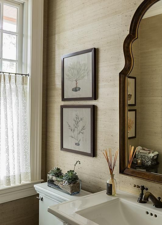 Beautiful Tan And Brown Powder Room Features A Brown Arch Mirror