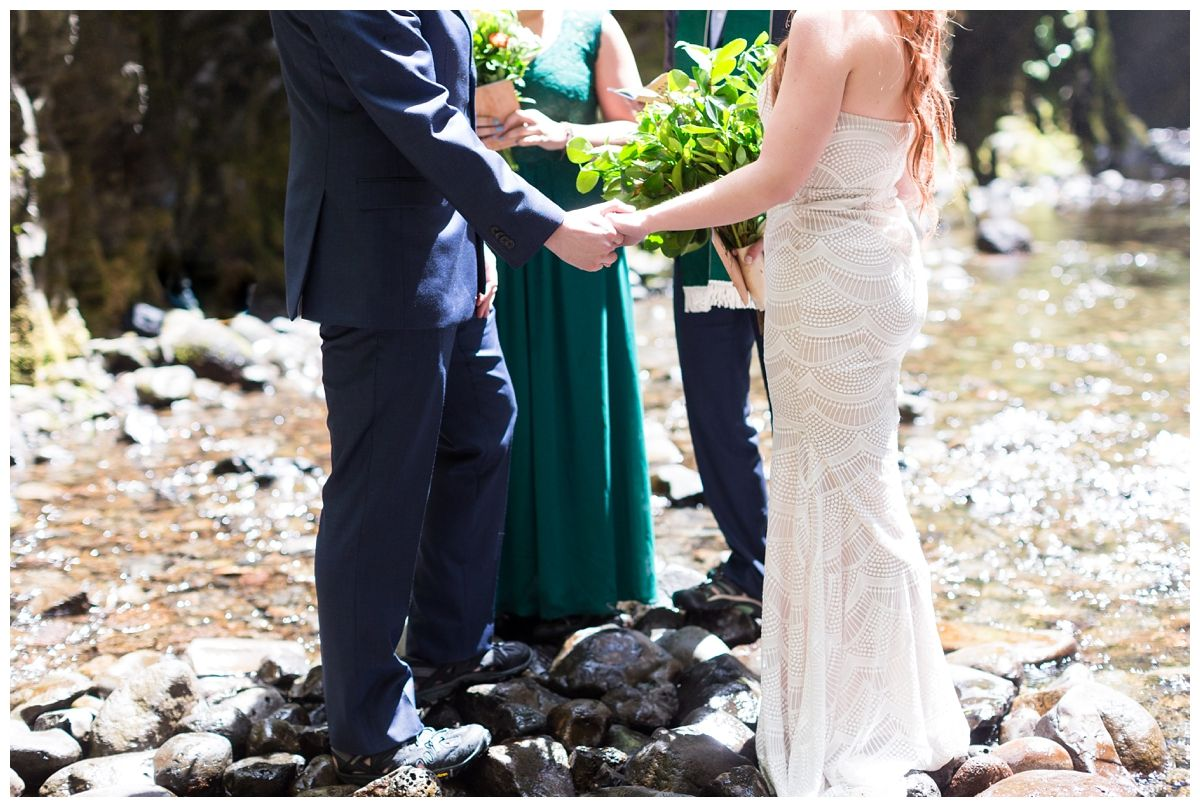 Destination Elopement Ceremony | bride and groom getting married just outside of Portland near a waterfall