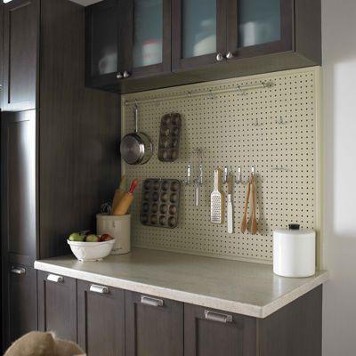 A #DIY pegboard is a practical kitchen storage solution that keeps